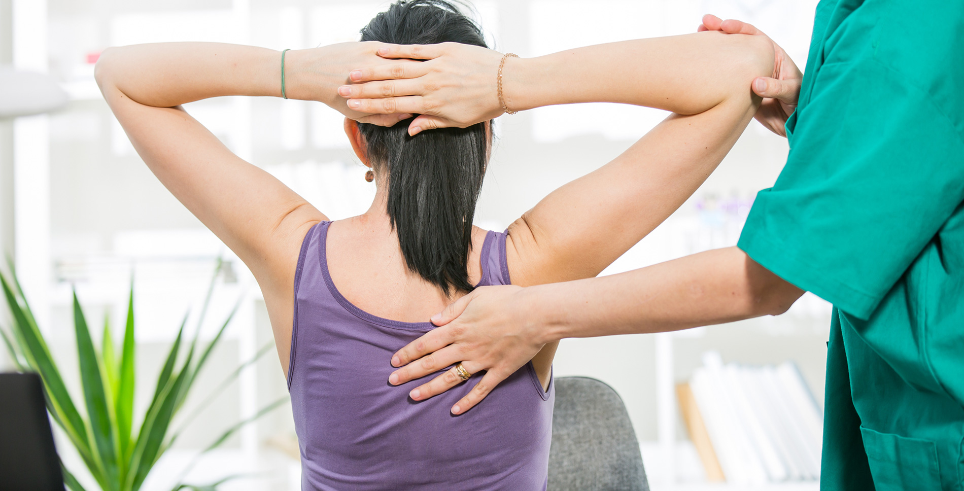Woman receiving chiropractic adjustment from chiropractor