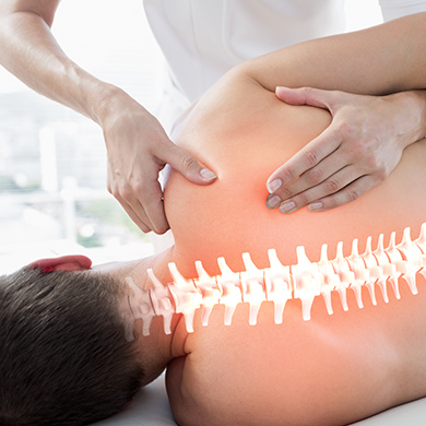 Illuminated spine of patient receiving chiropractic care from chiropractor