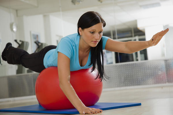 Woman on exercise ball at chiropractic office